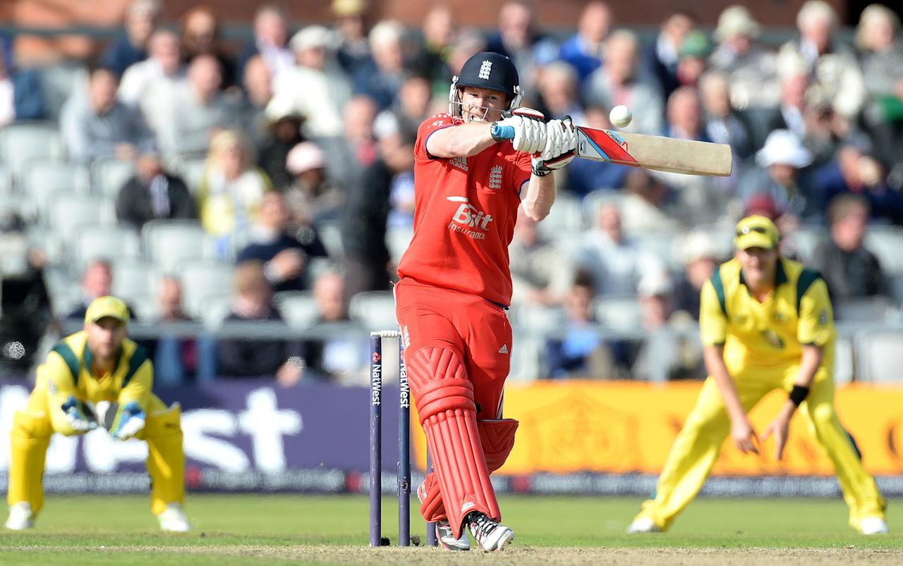 England's Eoin Morgan hits out from the bowling of Australia's Mitchell Johnson, during the Second One Day International at Old Trafford Cricket Ground, Manchester.