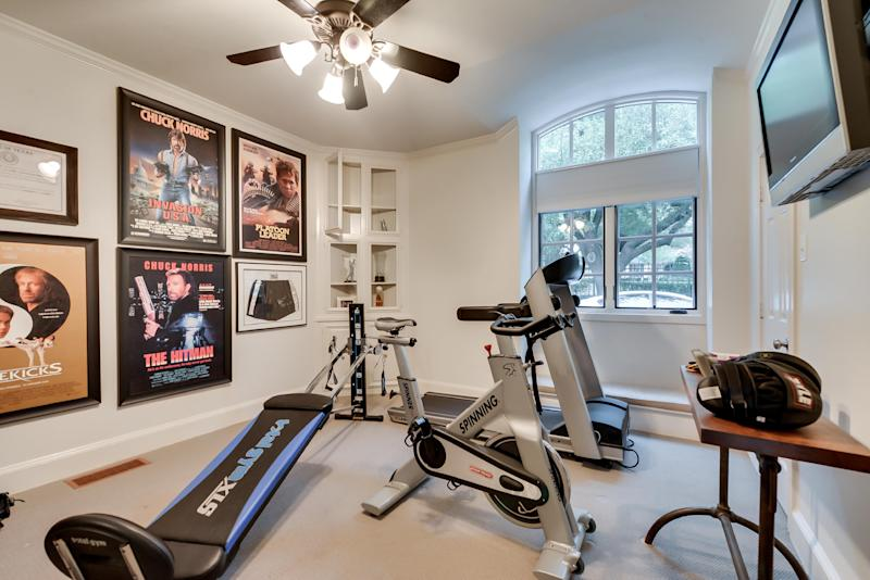 "This July 15, 2013 photo courtesy of Rogers Healy and Associates Real Estate shows the gym in Texas Ranger Cordell Walker's house from the former television series ""Walker, Texas Ranger,"" in Dallas. Rogers Healy, of Rogers Healy and Associates Real Estate has listed the 7,362-square-foot home for $1.2 million. The seven-bathroom and four-bedroom has been extensively renovated since the show ended in 2001. (AP Photo/Rogers Healy and Associates Real Estate)"