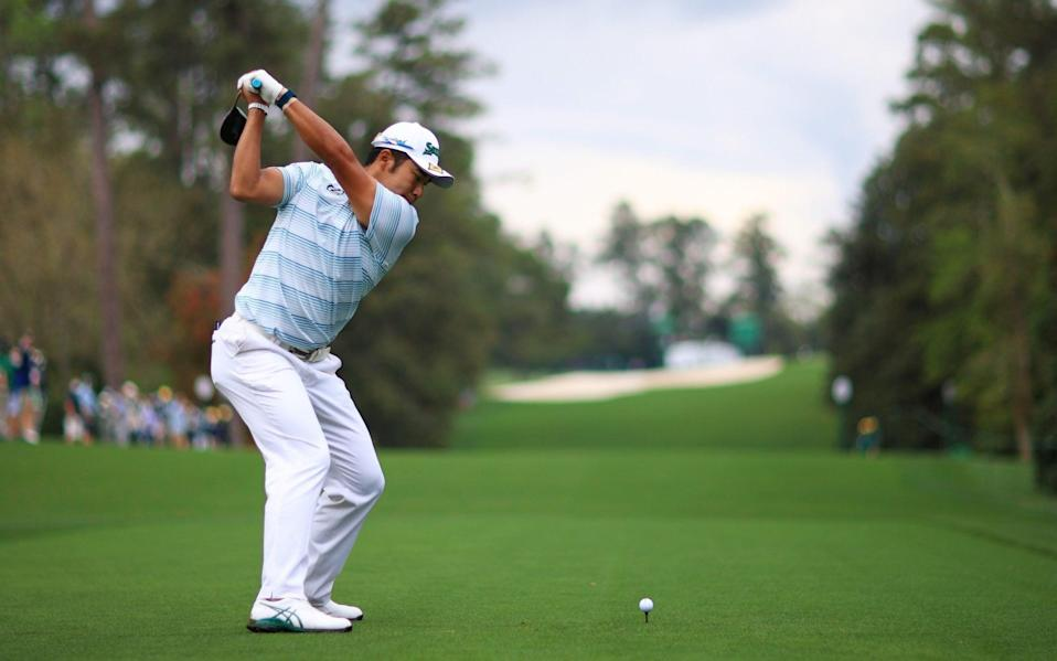 Hideki Matsuyama of Japan plays his shot from the 18th tee during the third round  - Getty Images