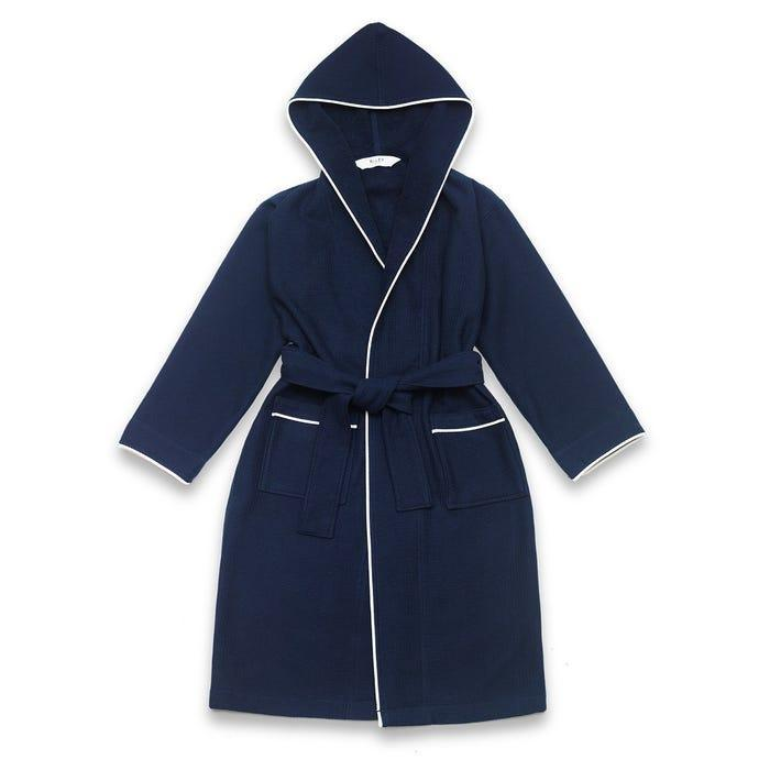 """Personalized bathrobes make a great gift for newlyweds–and this hooded, terry-lined version from Riley Home will get them settled in in no time. The brand also offers customization options on their shams and bath sheets that are a more contemporary take on monograms of yore. $119, RiLEY Home. <a href=""""https://www.rileyhome.com/navy-hooded-waffle-robe"""" rel=""""nofollow noopener"""" target=""""_blank"""" data-ylk=""""slk:Get it now!"""" class=""""link rapid-noclick-resp"""">Get it now!</a>"""