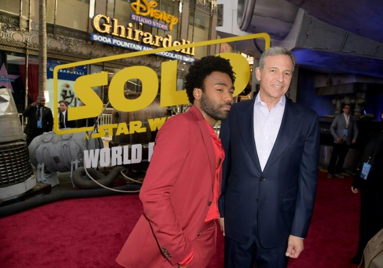 """Disney CEO Bob Iger -- shown here with """"Solo: A Star Wars Story"""" star Donald Glover at the film's Hollywood premiere in May 2018 -- said last year that the studio would slow down its release schedule for the franchise, and now it has"""
