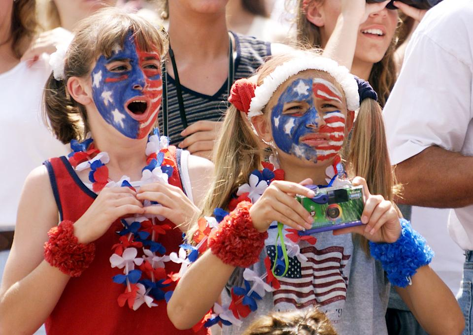 USWNT fans cheer as the teams come onto the field before the first-round game against Denmark at the 1999 FIFA Women's World Cup at Giants Stadium in East Rutherford, New Jersey on June 19, 1999. (TIMOTHY A. CLARY/AFP via Getty Images)