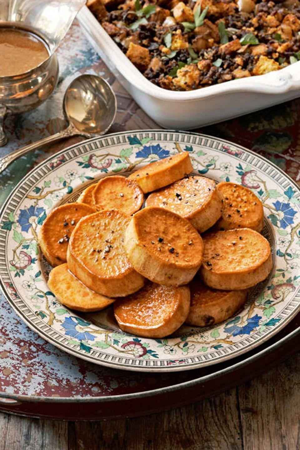 """<p>A Thanksgiving meal wouldn't be complete without this sweet side dish.</p><p><strong><a href=""""https://www.countryliving.com/food-drinks/recipes/a3056/lemon-glazed-sweet-potatoes-recipe/"""" rel=""""nofollow noopener"""" target=""""_blank"""" data-ylk=""""slk:Get the recipe"""" class=""""link rapid-noclick-resp"""">Get the recipe</a>.</strong></p>"""