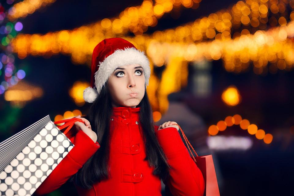 Flustered Woman Holding Holiday Shopping Bags