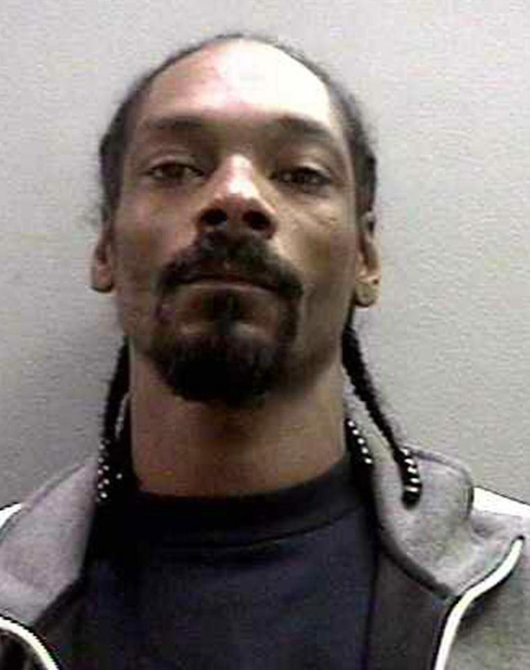 <b>Who:</b> Snoop Dogg<br><b>What:</b> Four days after a warrant was issued for his arrest, the rapper turned himself in to the authorities and was booked on one felony count of possession of a deadly weapon. A collapsible baton was found in his carry-on at John Wayne Airport.<br><b>Where:</b> Orange County, California <br><b>When:</b> November 6, 2006