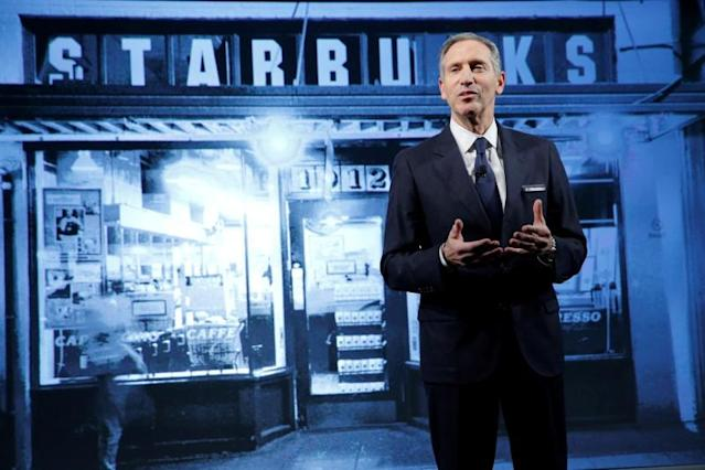 FILE PHOTO: Starbucks Chairman and CEO Howard Schultz delivers remarks at the Starbucks 2016 Investor Day in Manhattan, New York, U.S., December 7, 2016. REUTERS/Andrew Kelly/File Photo