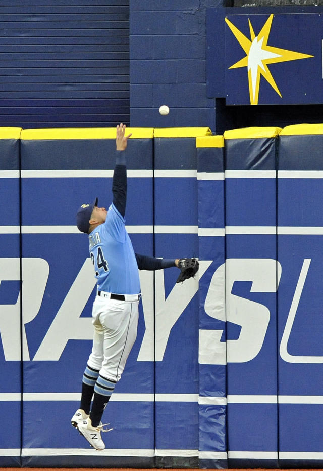 Tampa Bay Rays' Avisail Garcia stretches to reach a RBI-triple off the wall hit by Chicago White Sox's Yolmer Sanchez during the seventh inning of a baseball game Sunday, July 21, 2019, in St. Petersburg, Fla. (AP Photo/Steve Nesius)