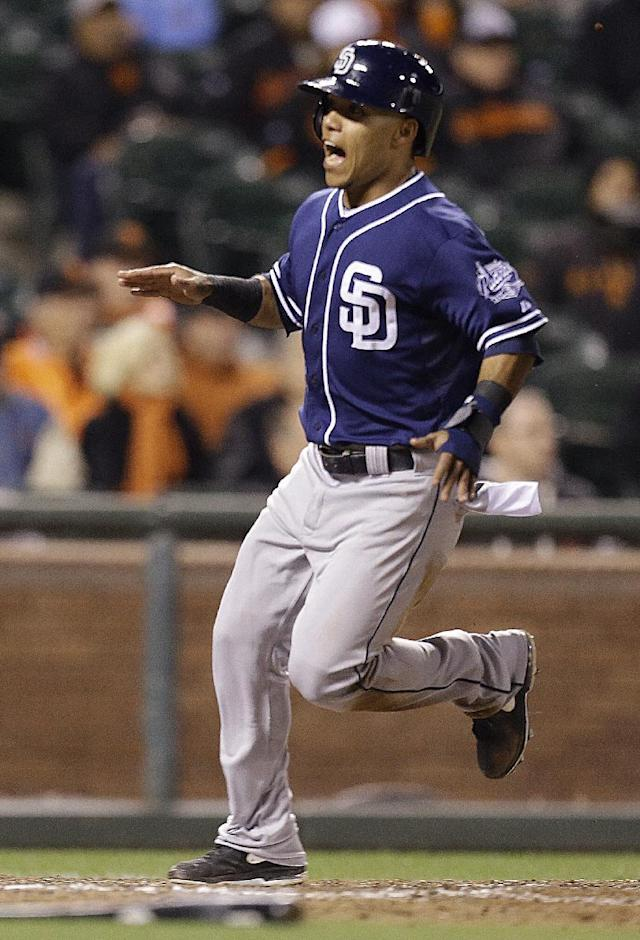 San Diego Padres' Alexi Amarista reacts after scoring against the San Francisco Giants in the 13th inning of a baseball game Monday, June 17, 2013, in San Francisco. (AP Photo/Ben Margot)