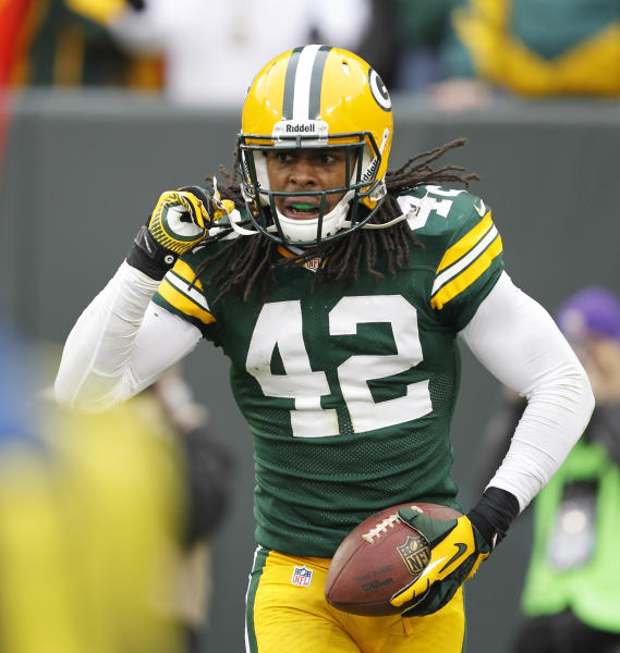 Green Bay Packers' Morgan Burnett reacts after intercepting a pass during the second half of an NFL football game against the Minnesota Vikings Sunday, Dec. 2, 2012, in Green Bay, Wis. (AP Photo/Mike Roemer)