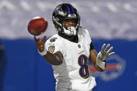 Baltimore Ravens quarterback Lamar Jackson (8) throws a pass during the first half of an NFL divisional round football game against the Buffalo Bills Saturday, Jan. 16, 2021, in Orchard Park, N.Y. (AP Photo/John Munson)