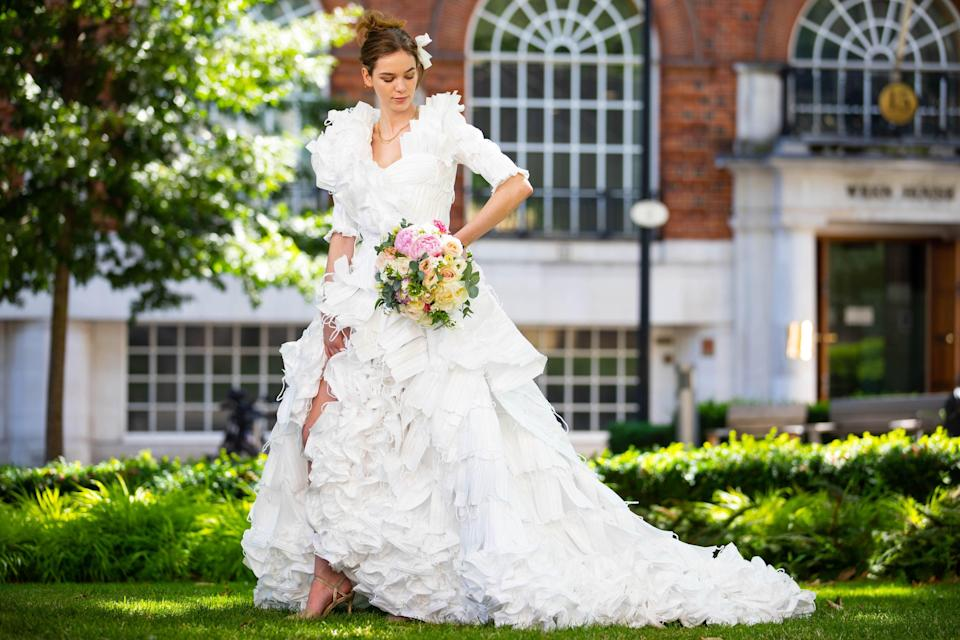 The dress was unveiled to celebrate the lifting of restrictions on weddings in England from Monday (David Parry/PA) (PA Wire)