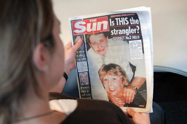 A woman reads the frontpage of Britain's