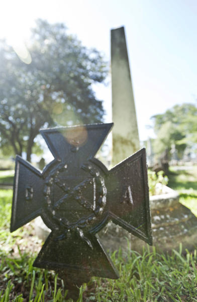 In this photo taken Sept. 18, 2012, a metal and a stone monument mark the grave of David Owen Dodd in Little Rock, Ark. The 17-year-old boy was executed in 1864 for being a Confederate spy. (AP Photo/Danny Johnston)