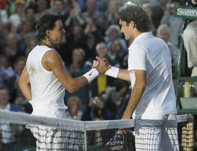 FILE - In this Sunday, July 6, 2008 file photo Spain's Rafael Nadal left, shakes the hand of Switzerland's Roger Federer after winning the men's final on the Centre Court at Wimbledon. After going more than 1 years without playing each other anywhere, Roger Federer and Rafael Nadal will be meeting at a second consecutive Grand Slam tournament when they face off in Wimbledon's semifinals. (AP Photo/Anja Niedringhaus, File)
