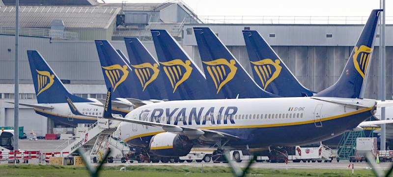 "File photo dated 3/4/2020 of Ryanair jets parked on the runway of Dublin airport. The budget airline group has announced that up to 3,000 jobs across pilots and cabin crew will be cut in a restructuring programme that could also involve unpaid leave, pay slashed by up to 20%, and the closure of ""a number of aircraft bases across Europe"" until demand for air travel recovers."