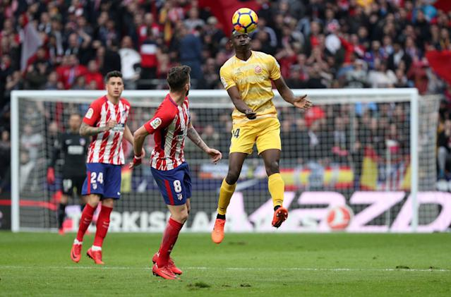 Soccer Football - La Liga Santander - Atletico Madrid vs Girona - Wanda Metropolitano, Madrid, Spain - January 20, 2018 Girona's Michael Olunga in action with Atletico Madrid's Saul Niguez REUTERS/Sergio Perez