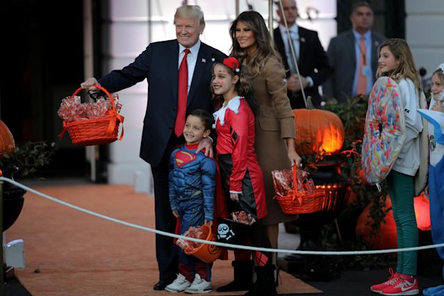 <p>U.S. President Donald Trump and First Lady Melania Trump pose for a picture as they give out Halloween treats to children from the South Portico of the White House in Washington, D.C. on Oct. 30, 2017. (Photo: Carlos Barria/Reuters) </p>