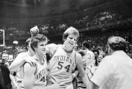 FILE - Indiana's Kent Benson (54) is congratulated by teammate Jim Chews, left, after Indiana beat Michigan 86-68 to win the NCAA college basketball championship game in Philadelphia, in this March 30, 1976, file photo. (AP Photo/File)