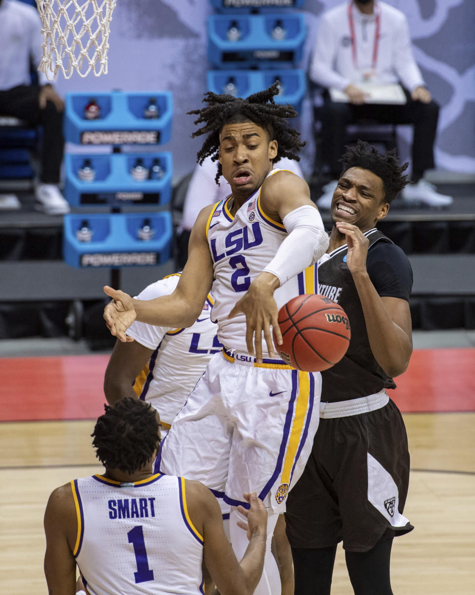 LSU forward Trendon Watford (2) loses control of the ball as he tries to grab a rebound during the first half of a first round game against St. Bonaventure in the NCAA men's college basketball tournament, Saturday, March 20, 2021, at Assembly Hall in Bloomington, Ind. (AP Photo/Doug McSchooler)