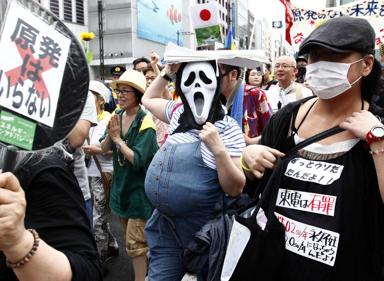 Demonstrators march near the headquarters of Tokyo Electric Power Co. (TEPCO) during their anti-nuclear power protest, in Tokyo, Saturday, Aug. 6, 2011. TEPCO's Fukushima Dai-ichi nuclear power plant was crippled by an earthquake and tsunami March 11, which caused the worst nuclear crisis since Chernobyl. (AP Photo/Shizuo Kambayashi)