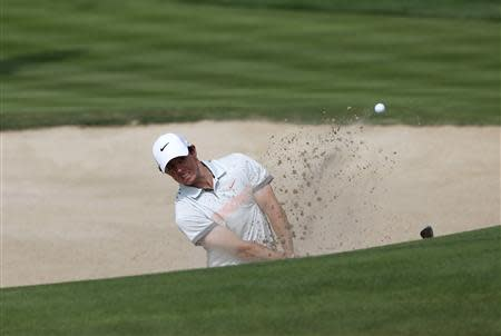 Rory McIlroy of Northern Ireland hits the ball out of the bunker on the third hole during the second round of the 2014 Omega Dubai Desert Classic in Dubai January 31, 2014. REUTERS/Ahmed Jadallah