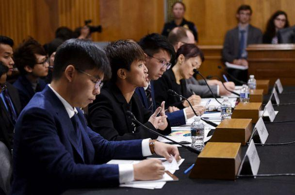 PHOTO: Joshua Wong listens as Denise Ho (C), pro-Democracy activist and Cantopop singer testifies before the Congressional-Executive Commission on China about the pro-democracy movement in Hong Kong, on September 17, 2019, in Washington, D.C.s (Olivier Douliery/AFP/Getty Images)