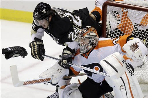Pittsburgh Penguins' Matt Cooke (24) collides with Philadelphia Flyers goalie Sergei Bobrovsky during the first period of an NHL hockey game in Pittsburgh Saturday, April 7, 2012. (AP Photo/Gene J. Puskar)