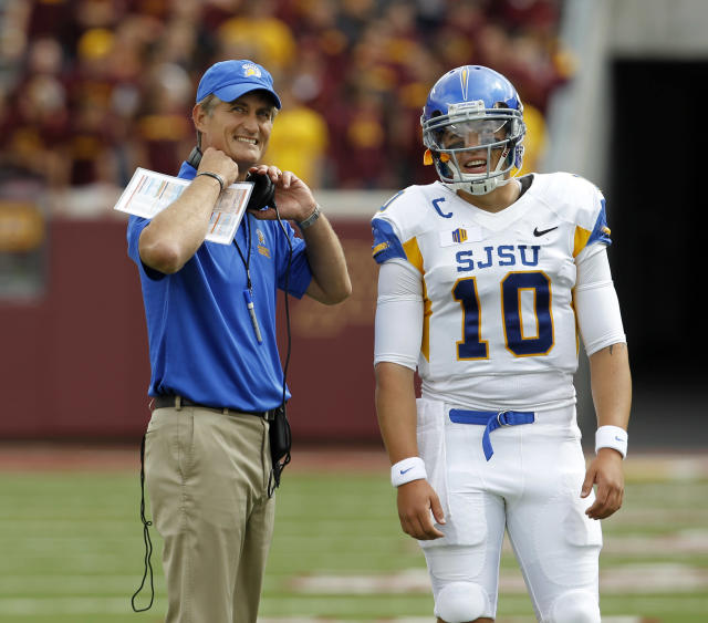 San Jose State head coach Ron Caragher, left, and quarterback David Fales (10) watch as a play is reviewed during the first quarter of an NCAA college football game against Minnesota in Minneapolis, Saturday, Sept. 21, 2013. (AP Photo/Ann Heisenfelt)