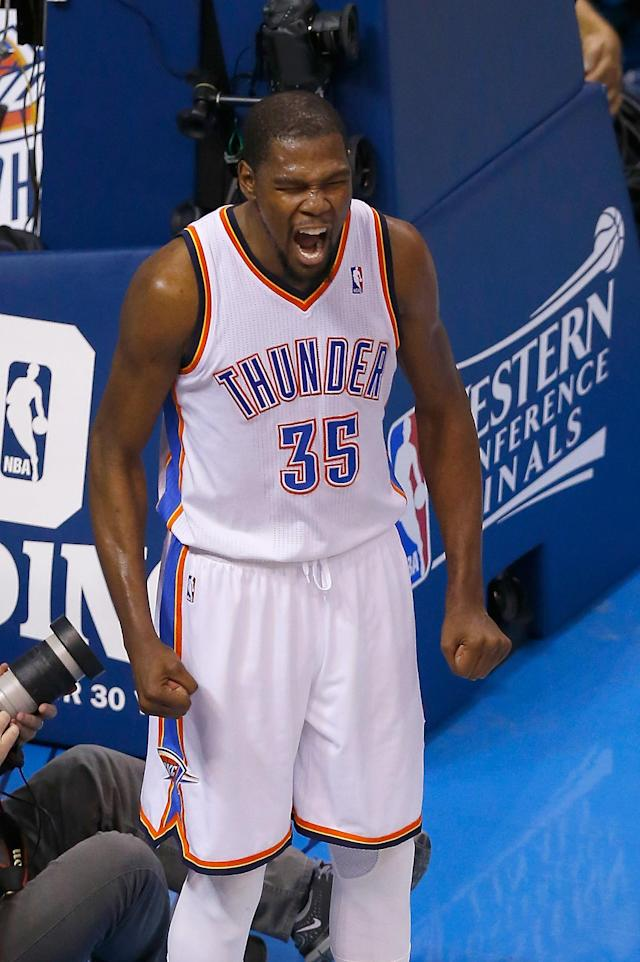 OKLAHOMA CITY, OK - MAY 31: Kevin Durant #35 of the Oklahoma City Thunder celebrates after a play against the San Antonio Spurs in the first half during Game Six of the Western Conference Finals of the 2014 NBA Playoffs at Chesapeake Energy Arena on May 31, 2014 in Oklahoma City, Oklahoma. (Photo by Tom Pennington/Getty Images)