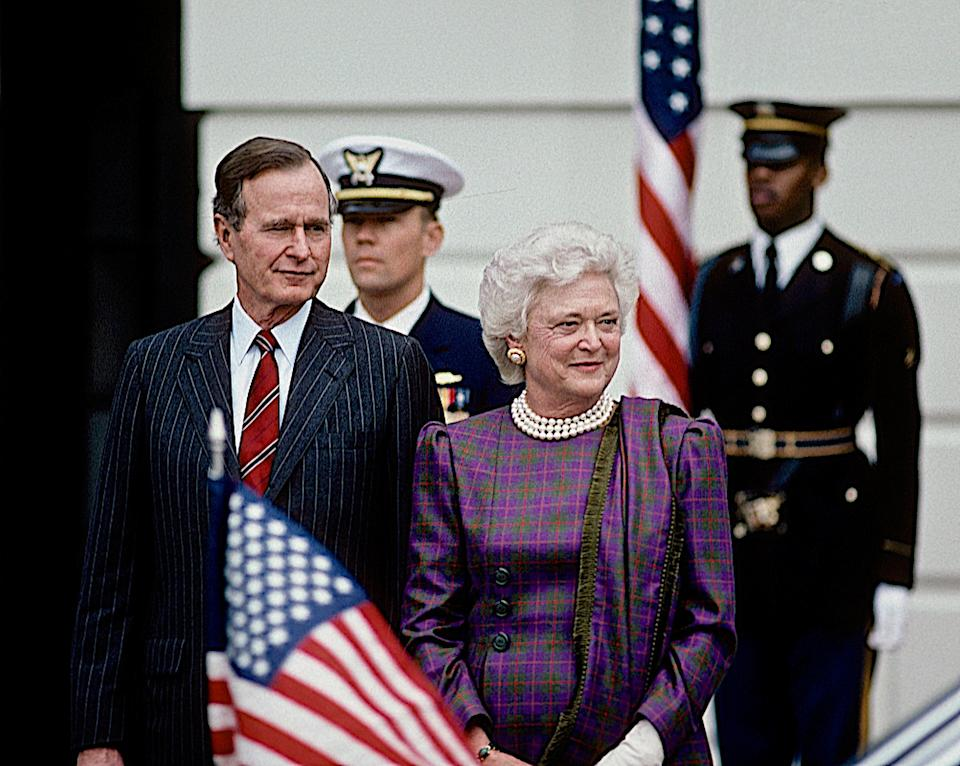 Barbara Bush stands next to President George H.W. Bush outside the South Portico diplomatic entrance to the White House as they wait the arrival of Prime Minister Anibal Cavacu Silva of Portugal on Jan. 11, 1990.