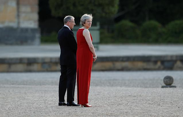 <p>British Prime Minster Theresa May and her husband Philip, wait to welcome President Donald Trump and first lady Melania Trump to Blenheim Palace, where they are attending a dinner with specially invited guests and business leaders, near Oxford, Britain, July 12, 2018. (Photo: Peter Nicholls/Reuters) </p>