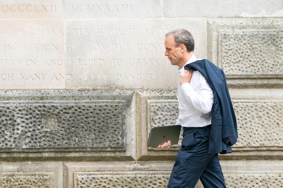 Foreign Secratary Dominic Raab arrives at the Foreign Office in Westminster, London, as he faces mounting pressure to resign after it emerged a phone call requested by his officials to help interpreters flee Afghanistan was not made. Picture date: Friday August 20, 2021. (Photo by Dominic Lipinski/PA Images via Getty Images)