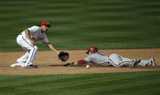 Washington Nationals second baseman Anthony Rendon as he makes the catch to tag out Arizona Diamondbacks' Gerardo Parra, right, who was caught stealing in the third inning of a baseball game at Nationals Park, Thursday, June 27, 2013, in Washington. (AP Photo/Pablo Martinez Monsivais)