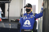 William Byron watches as crew members ready his car in the garage before the start of a NASCAR Daytona 500 auto race practice session at Daytona International Speedway, Wednesday, Feb. 10, 2021, in Daytona Beach, Fla. (AP Photo/John Raoux)