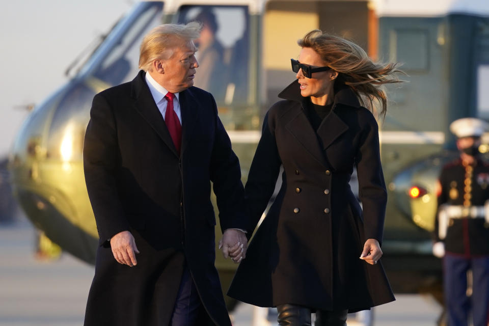 President Donald Trump and first lady Melania Trump walk to board Air Force One at Andrews Air Force Base, Md., Wednesday, Dec. 23, 2020. Trump is traveling to his Mar-a-Lago resort in Palm Beach, Fla. (AP Photo/Patrick Semansky)