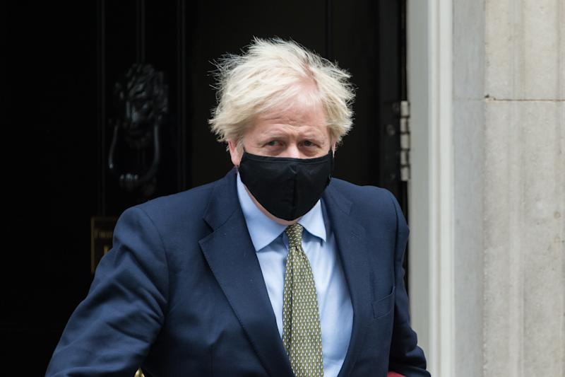 British Prime Minister Boris Johnson leaves 10 Downing Street for PMQs at the House of Commons on 14 October, 2020 in London, England.