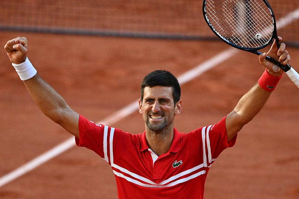 TOPSHOT - Serbia's Novak Djokovic celebrates after winning against Greece's Stefanos Tsitsipas at the end of their men's final tennis match on Day 15 of The Roland Garros 2021 French Open tennis tournament in Paris on June 13, 2021. (Photo by Christophe ARCHAMBAULT / AFP) (Photo by CHRISTOPHE ARCHAMBAULT/AFP via Getty Images)