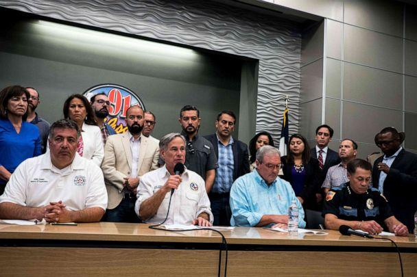 PHOTO: Texas Governor Greg Abbott, joined by El Paso city officials, speaks during a press briefing following a mass fatal shooting, at the El Paso Regional Communications Center in El Paso, Texas, Aug. 3, 2019. (Joel Angel Juarez/AFP/Getty Images)