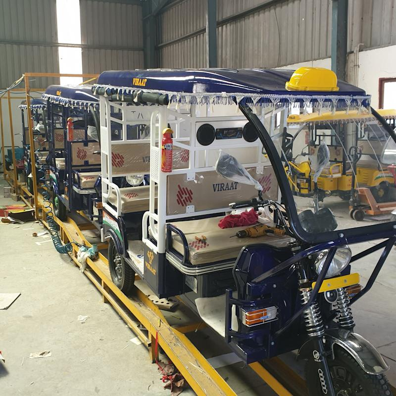 Newly manufactured e-rickshaws fitted with Lead Acid batteries (LABs) set to hit the streets, at a manufacturing company in Dera Bassi, Punjab. (Photo: Huffpost India)