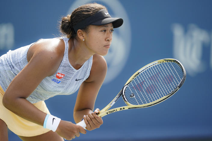 Naomi Osaka, of Japan, waits for a serve from Sofia Kenin, of the United States, during the Western & Southern Open tennis tournament, Friday, Aug. 16, 2019, in Mason, Ohio. (AP Photo/John Minchillo)