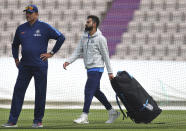 India's captain Virat Kohli, right, walks past team coach Ravi Shastri before batting in the nets during a training session ahead of their Cricket World Cup match against South Africa at Ageas Bowl in Southampton, England, Monday, June 3, 2019. (AP Photo/Aijaz Rahi)