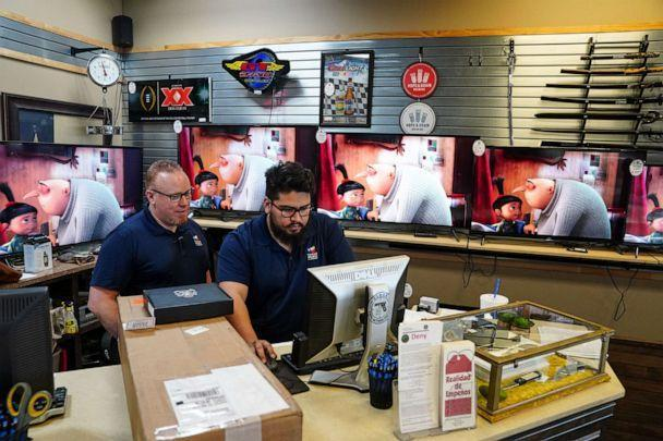 PHOTO: Employees work at pawn shop that is not enforcing the statewide mask mandate on march 3, 2021 in Leander, Texas. Texas Gov. Greg Abbott has said the mask mandate would expire on March 10. (Ilana Panich-Linsman/The New York Times via Redux)