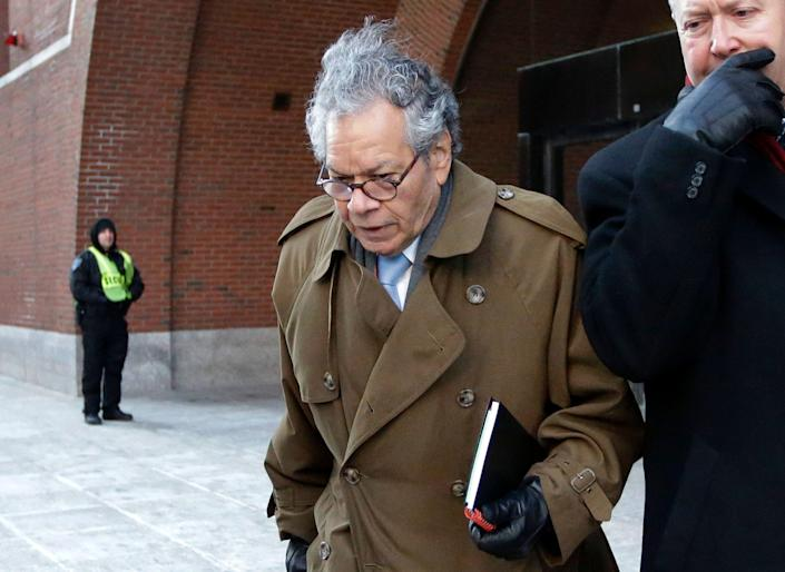 FILE - In this Jan. 30, 2019, file photo, Insys Therapeutics founder John Kapoor leaves federal court in Boston. He is one of four former company executives accused of scheming to bribe doctors into prescribing a powerful fentanyl painkiller. Lawyers are delivering their closing arguments Thursday, April 4, 2019, in the trial. (AP Photo/Steven Senne, File) ORG XMIT: BX105
