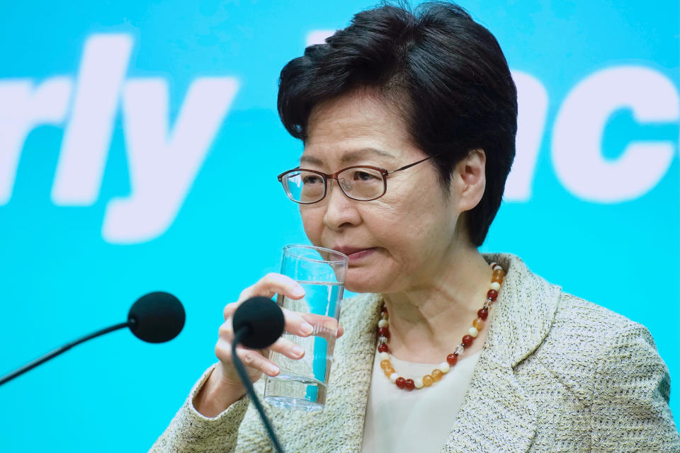 """Hong Kong Chief Executive Carrie Lam drinks water during a press conference in Hong Kong, Tuesday, June 15, 2021. Lam said that her government is """"highly concerned"""" about the situation at a nearby nuclear power plant in mainland China, following media reports that the plant could be experiencing a leak. (AP Photo/Vincent Yu)"""