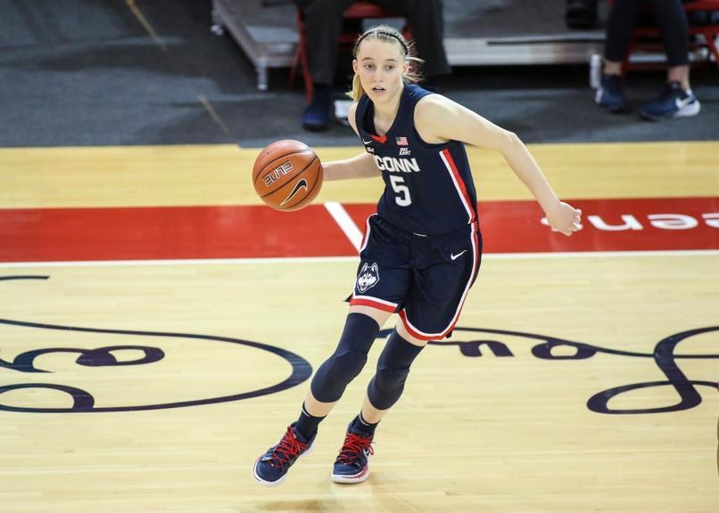 Paige Bueckers dribbles in navy blue UConn uniform