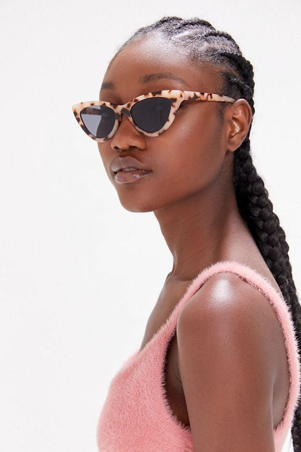 """<p>These <a href=""""https://www.popsugar.com/buy/Lizzie-Cat-Eye-Sunglasses-498921?p_name=Lizzie%20Cat-Eye%20Sunglasses&retailer=urbanoutfitters.com&pid=498921&price=16&evar1=savvy%3Aus&evar9=46725265&evar98=https%3A%2F%2Fwww.popsugar.com%2Fphoto-gallery%2F46725265%2Fimage%2F46725707%2FLizzie-Cat-Eye-Sunglasses&list1=shopping%2Cgifts%2Curban%20outfitters%2Cgift%20guide%2Cgifts%20under%20%2425&prop13=api&pdata=1"""" rel=""""nofollow"""" data-shoppable-link=""""1"""" target=""""_blank"""" class=""""ga-track"""" data-ga-category=""""Related"""" data-ga-label=""""https://www.urbanoutfitters.com/shop/lizzie-cat-eye-sunglasses?category=womens-clothing&amp;color=015"""" data-ga-action=""""In-Line Links"""">Lizzie Cat-Eye Sunglasses</a> ($16) will soon become her favorite go-to accessory.</p>"""