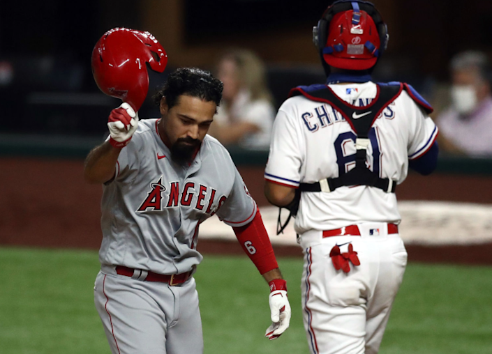 "Angels third baseman Anthony Rendon throws off his helmet after striking out against the Texas Rangers on Saturday. <span class=""copyright"">(Ronald Martinez / Getty Images)</span>"
