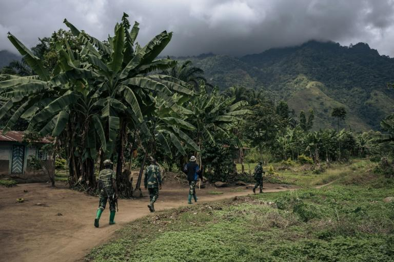 Troops patrol the village of Mwenda, which recently came under attack by the ADF