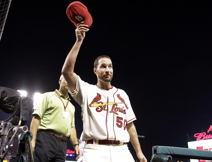 Adam Wainwright acknowledge the crowed after completing his 10th career shutout. (AP)