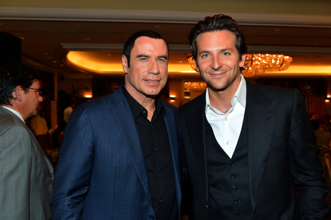 John Travolta and Bradley Cooper attend at the Hollywood Foreign Press Association's 2012 Luncheon held at the Beverly Hill Hotel on August 9, 2012.